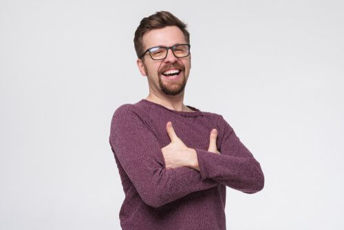 laughing male with glasses