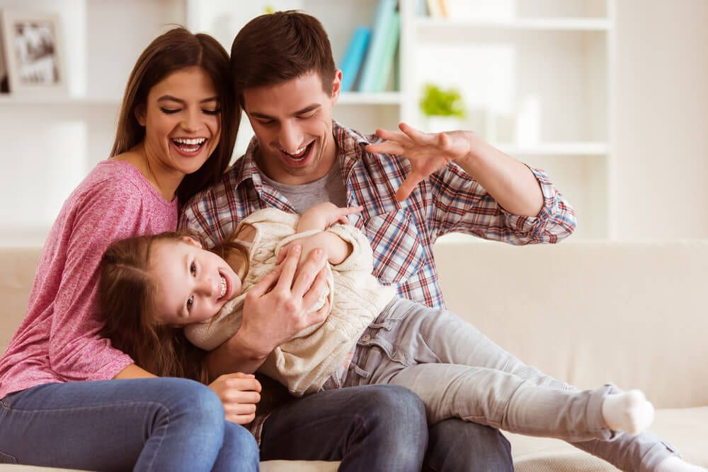 family playing with child after dental appointment